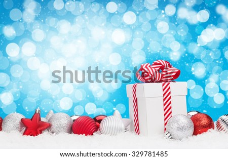 Christmas background with baubles, gift box and bokeh copy space - stock photo