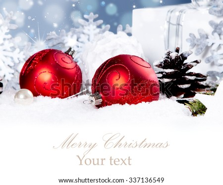 Christmas background with baubles,snow and snowflakes