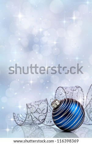 Christmas background with blue ornament and curled ribbon - stock photo