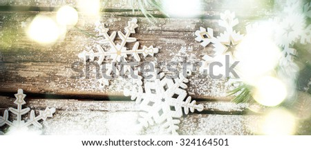 Christmas Background with Bright Glow and White Wooden Decorative Snowflakes on Old Vintage Background, as Christmas Decor - stock photo