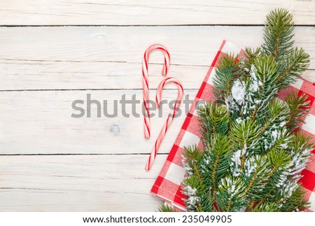 Christmas background with candy cane and snow fir tree. View from above - stock photo