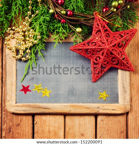 Christmas background with chalkboard and ornaments - stock photo