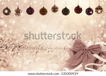 Christmas background with christmas ball and snow on glitter bokeh background