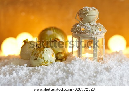 Christmas background with christmas baubles and lantern in snow - stock photo