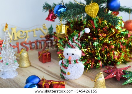 Christmas background with christmas decoration on an old wood surface