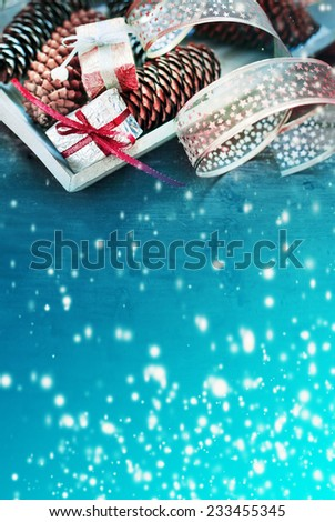 Christmas background with christmas decorations and gift / toned pictures - stock photo