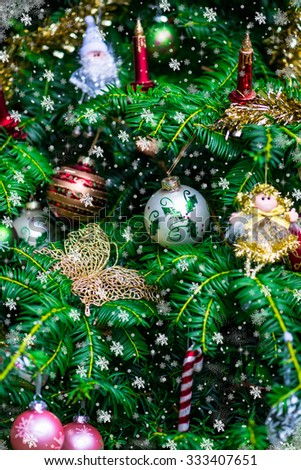 Christmas Background with Christmas Tree and Decorations such as Fairies, Butterfly, Candles and Glass Balls, Shallow DOF, Selective Focus - stock photo