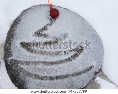 Christmas background with Christmas tree and red ball on snow