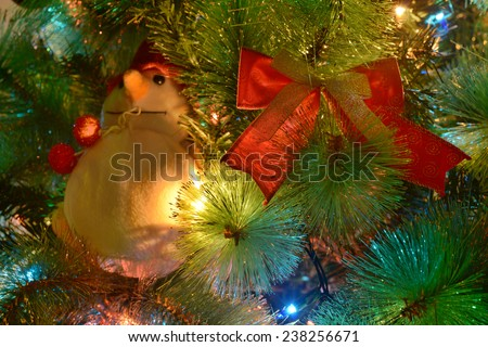 Christmas background with Christmas tree decoration and snowman - stock photo