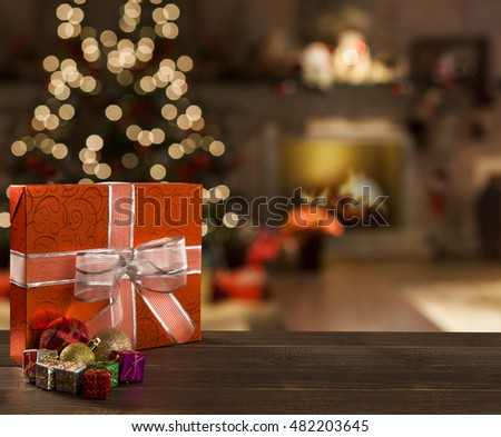 Christmas background with Christmas tree on wooden table. Red, golden and silver ornaments