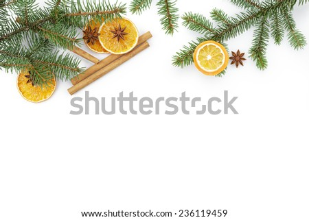 christmas background with cinnamon anise and oranges, white copy space - stock photo
