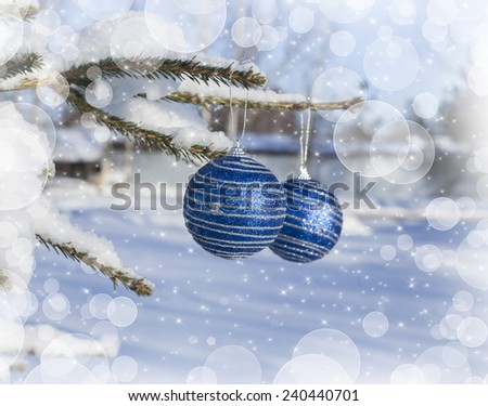 Christmas background with colorful balls on the christmas tree in winter under snow - stock photo