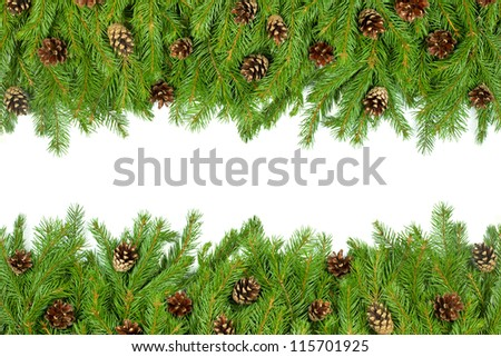 Christmas background with cones isolated on white - stock photo