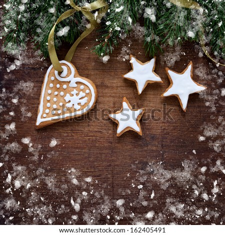 Christmas background with cookies on the wooden background - stock photo