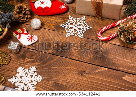 Christmas background with decor and fir tree branch on wooden table. Top view, with free space for you text.