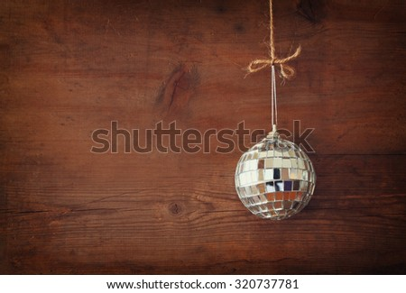 christmas background with decoration hanging on a rope over wooden background - stock photo