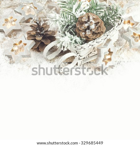 Christmas background with decoration with light star, cones and twigs