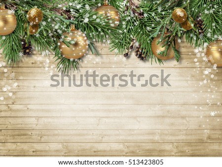 Christmas background with decorations and firtree on wooden boar