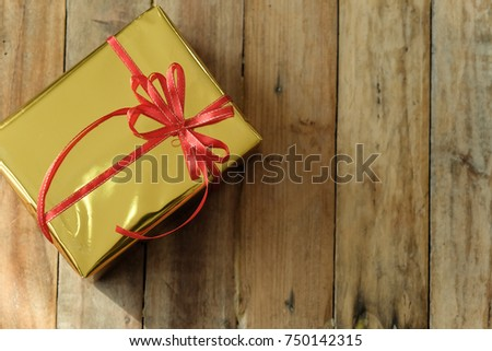 Christmas background with decorations and gift boxes on wooden board , top view and copy space