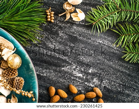 christmas background with decorations on a black table - stock photo