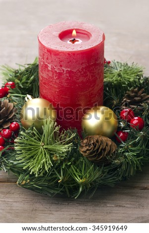 Christmas background with decorative rustic candle and baubles. - stock photo