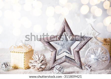 Christmas background with decorative star,gifts and pine cones - stock photo