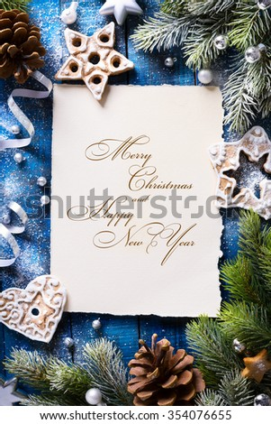 Christmas background with fir branches and Gingerbread cookies - stock photo