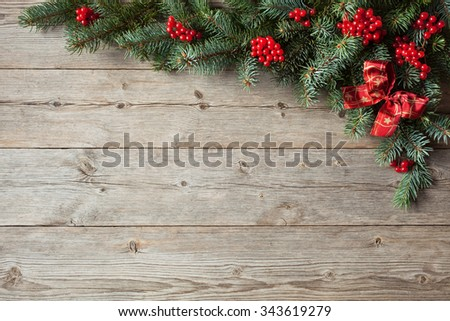 Christmas background with fir branches and red berries - stock photo
