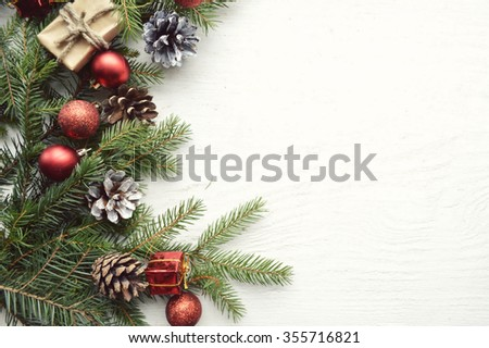 Christmas background with fir branches, pine cones, christmas cookies, cinnamon sticks and anise stars. Top view. Copy space