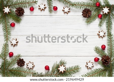 Christmas background with fir tree and Christmas cookies - stock photo