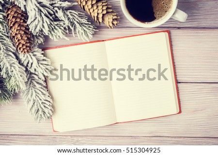 Christmas background with fir tree, coffee cup and open notebook