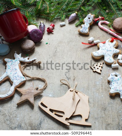 Christmas background with fir tree, decoration and gingerbread