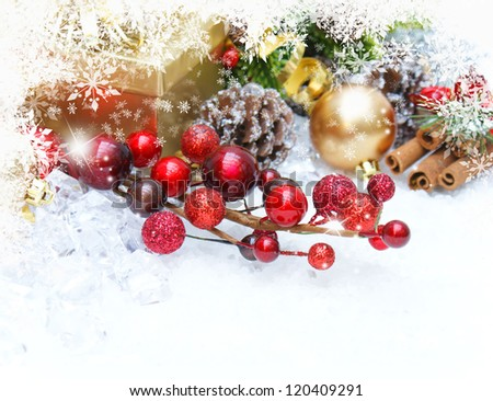 Christmas background with gift, berries and decorations - stock photo