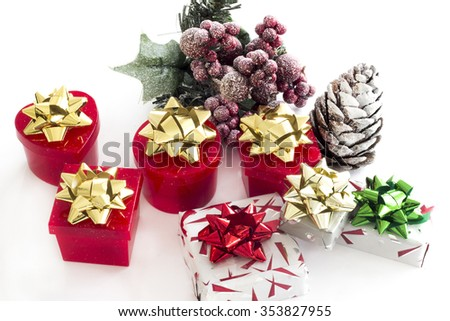 Christmas background with gift boxes, holly and pinecone
