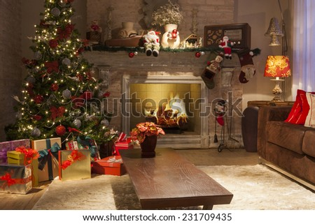 Christmas Background with gifts, lights, fire and decoration