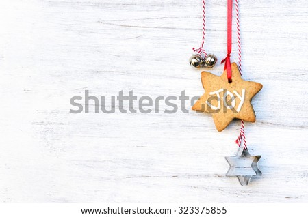 Christmas background with gingerbread decorations, silver bells and star cookie cutters, plenty of copy space - stock photo