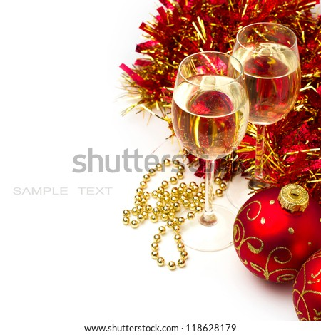 Christmas background with glasses of wine and ornaments over white - stock photo