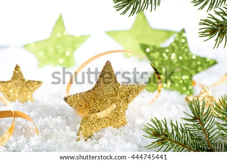 Christmas background with gold stars and christmas twig - stock photo