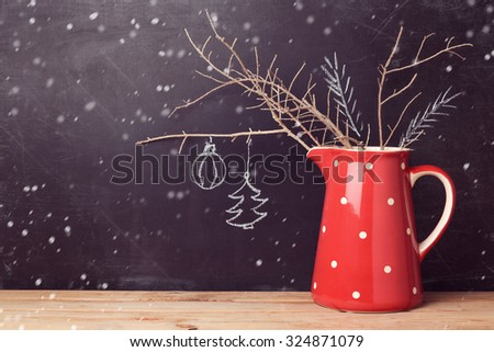 Christmas background with jug over chalkboard. Creative Christmas decorations. Alternative Christmas tree. - stock photo