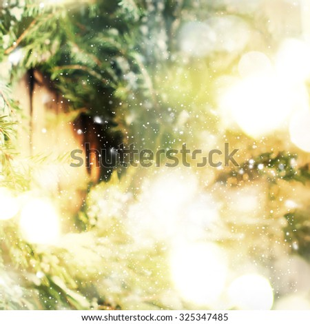 Christmas Background with Natural Wreath on Wooden Background and Festive Light. Warm toned - stock photo