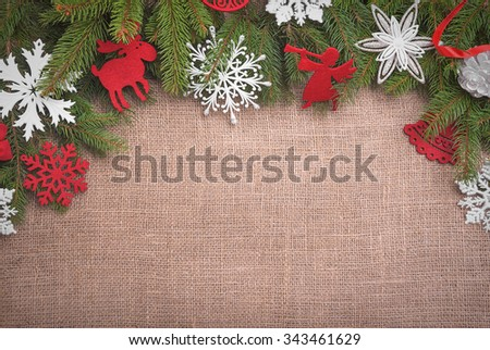 Christmas background with of burlap texture and toys. - stock photo