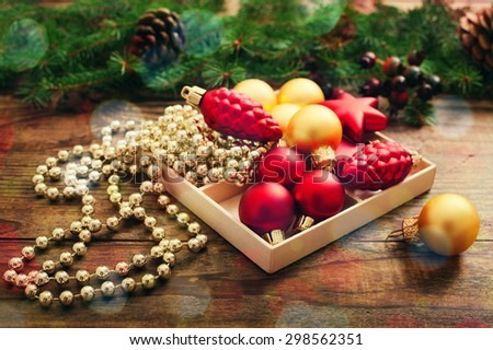 Christmas background with ornament and fir in snow.  - stock photo