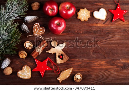 Christmas background with pine branches, red apples, nuts and Christmas toys. Space for writing a text or congratulations