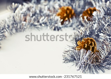 Christmas background with pine cones, shiny Christmas decoration on a white background with copy space, Grunge style,