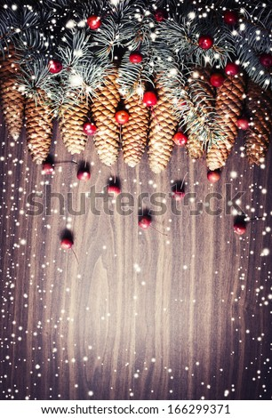Christmas background with pinecones and a red berry/ Christmas decoration with Pine Cone and snow - stock photo
