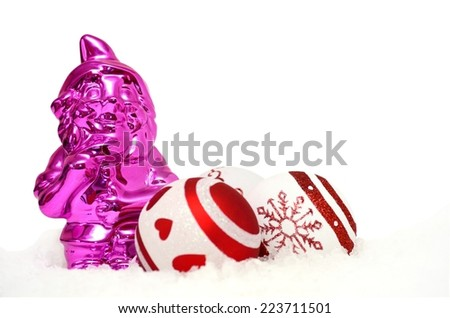 christmas background with pink gnome and baubles in snow - stock photo