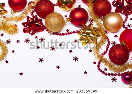 Christmas background with red and gold balls, stars and snowflakes, Isolated over white.