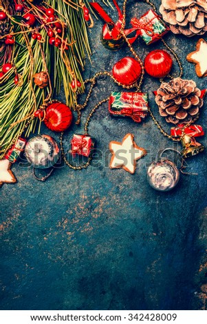 Christmas background with red and gold decorations, cookies and Fir branches, top view, border
