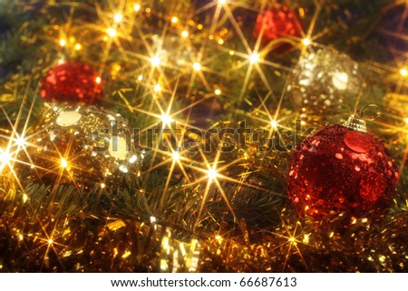 Christmas background with red and golden ornaments and Christmas lights - stock photo