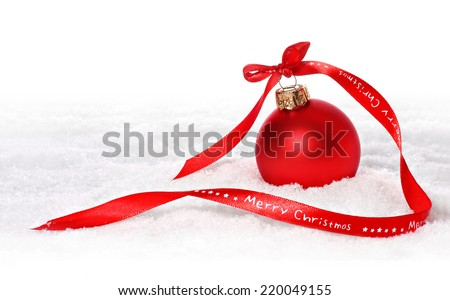 Christmas background with red bauble,snow and snowflakes Red bauble with merry christmas ribbon in snow  - stock photo